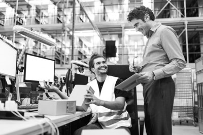 Men In Warehouse Office With Parts Stock BW